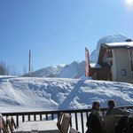 the restaurant on the slopes with the sun shinning