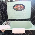                    weird restaurant tiles in fab art deco bathroom
