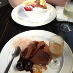 Dessert - chocolate terrine in foreground and raspberry creme brûlée in backgr