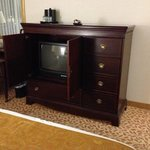 large media console and dresser console in our room.  TV is old CRT style.