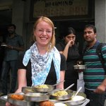  A vegetarian Swiss holds up her tray of thindi - vada, idly, kesri bhath