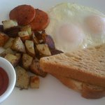Breakfast platter: fried eggs, portuguese (sp?) sausage, potatoes & toast