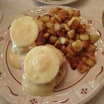 Eggs Benedict with hashbrowns. Also fresh fruit.