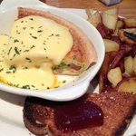 Ham and cheese breakfast quiche with home fries and toast