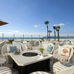 Windsor Cottage Patio, Beach Village's exclusive oceanfront patio for breakfast