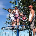 Family up top of climbing frame