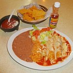 beef enchiladas, rice, salad, beans, chips and salsa