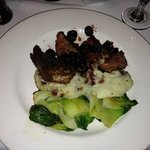duck with bing cherry sauce on a bed of blue cheese and bacon mash and bok choy