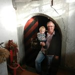 Owner Jurg with his grandson in front of the wine cellar