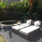 jacuzzi and sun loungers in our private garden