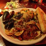                   Cioppino was spicy, lots of well prepared seafood over a large portion of ange