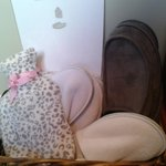 The lovely touch of slippers & hot water bottles for guests use