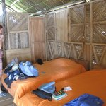 bedroom with open slats to allow a cool breeze to blow all the time