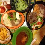  From the top and going clockwise: fresh guacamole, carne asada, tamale and fajita quesadilla.
