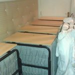 Beds being stored on public corridors.