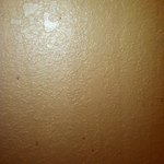                    grime on bathroom walls - only brown shows up after flash, but there others co