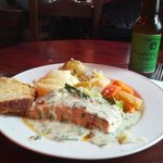 Baked Fresh Atlantic Salmon Served with a Pesto & Herb Crust, with a slice of carrot cake