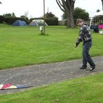 Attempting to fly a kite on the site!