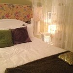                   Beautiful and comfy queen sized bed in bakeapple suite.