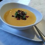 Sweet Potato & Apple Bisque topped with candied walnuts and dried cranberries