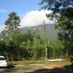 View of Arenal Volcano (in clouds) from parking lot