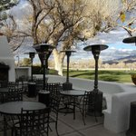 Patio seating with a view of golf course and mountains
