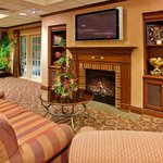 Watch TV and relax by the fireplace in the Great Room