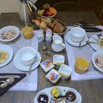 Fabrice takes breakfast seriously. No, that is not for a whole tour group; onl