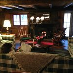  The toasty lounge w/ soft couches &amp; cast iron warmth