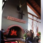 Enjoy wine by our outdoor fireplace !