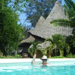 our pool, our hut at background