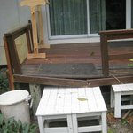                    entrance: steps GONE, deck broken, supported by snack tables