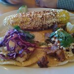 1Fish taco and 1 brisket taco and corn on the cob