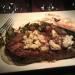 Strip Steak with gorgonzola butter, over creamy whipped potatoes with crispy b