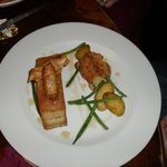 Confit pork belly with apple and sage spring rolls,sauté new potatoes and calv