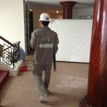 construction worker outside hotel room