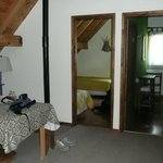 Our 2 upstairs rooms with open area with picnic table. Each room with 2 single