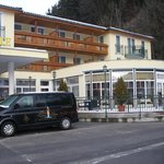                    Hotel front &amp; minibus for skiers