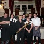                    The Dining Team with the Olympic Torch