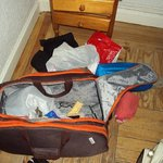 How my bag/room looked like after being ransacked. Drawers disheveled, bag rip