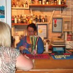                    Elizabeth serving behind the bar
