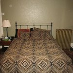                    Bed in Canyonlands room (Loved the radiator!)