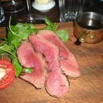 Chateaubriand in Bistro - well-used chopping board presentation!
