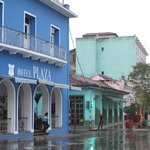 The bright blue Hotel del Rijo in the foreground - its a great location in the town square.