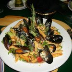                    Mussels in red sauce served over a bed of sauted greens and penne