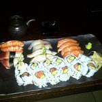 Large Plate of mixed sushi & rolls with crab and salmon.