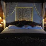 Four poster with carved headboard