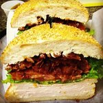 turkey with lettuce and bacon on a kaiser roll