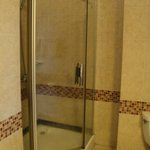 Big bathroom, small shower cubicle, no bath