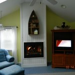 Fireplace in sitting area.
